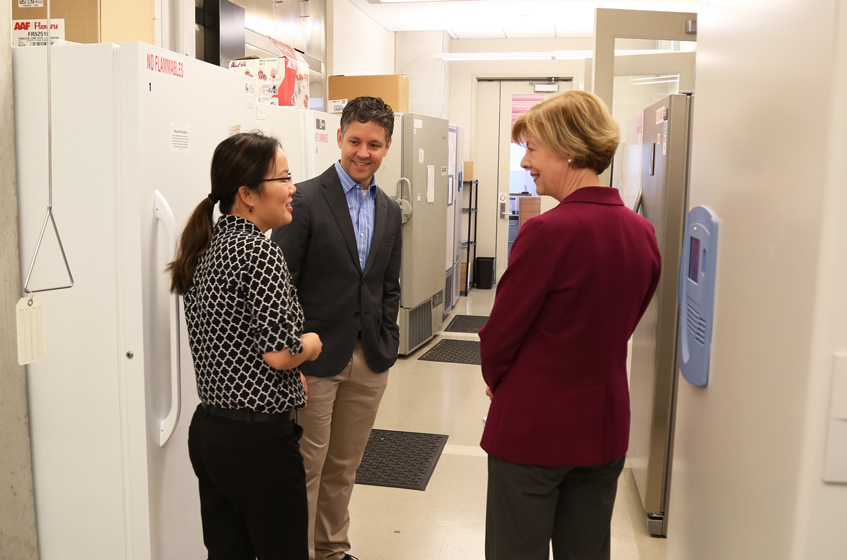 Jing Fan (left), an investigator in metabolism at Morgridge, with Dave Pagliarini (center), discusses how she integrates metabolomics and lipidomics approaches with biochemical, genetic, and computational tools to investigate metabolism.
